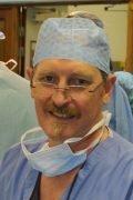 Austen Smith in surgical scrubs