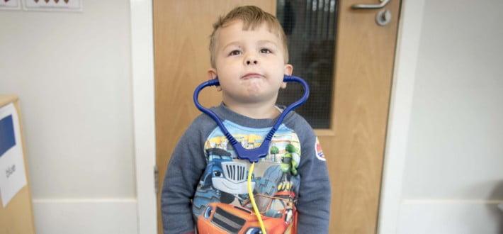 child with stethascope