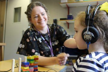 Audiologist checks a childs hearing