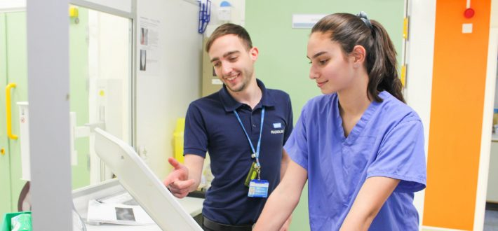 A radiology colleague works with a young female apprentice