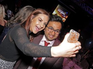 A young woman takes a selfie with Dr Rahul Mandal