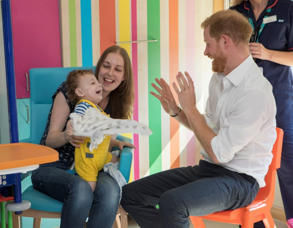 Noah and his mum Tracy playing with HRH Prince Harry