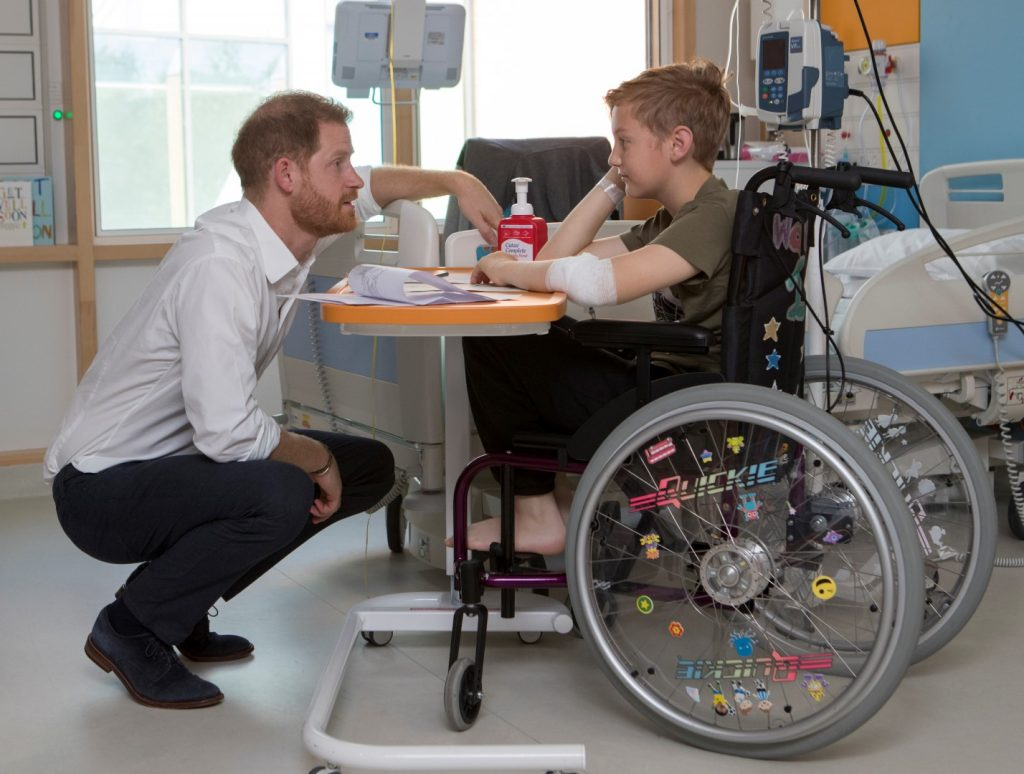 Prince Harry talks to young patient Heath