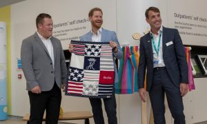 Prince Harry shows off a blanket for his son Archie, gifted to him by George Marriott, head of the Sheffield Childrens Youth Forum