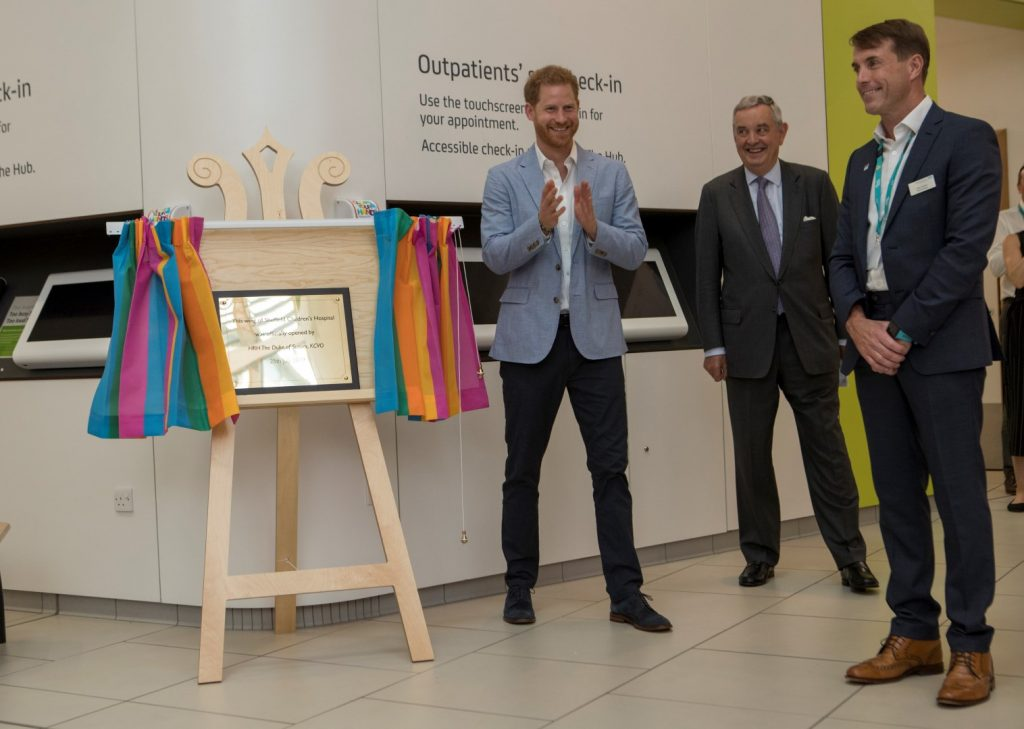 Prince Harry unveils a special plaque to officially open the new hospital wing