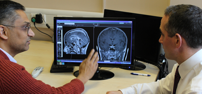 Two doctors discuss a brain scan