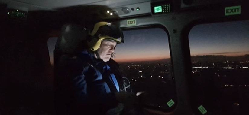 Pilot flying at dusk in air ambulance