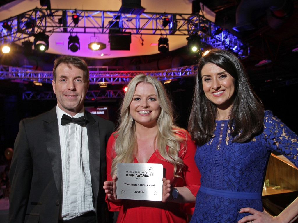 Children's Star Award winner Laura Butler with presenter Amy Garcia and Chief Executive John Somers