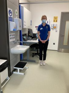 Harriet stood in clinic space at the advanced wellbeing research centre