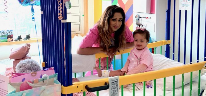 mum Anisa and two year old Amarah at Sheffield childrens - Amarah is in a brightly coloured cot, wearing a pink top